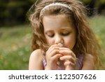 closeup portrait of charming... | Shutterstock . vector #1122507626