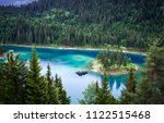 caumasee lake with a small... | Shutterstock . vector #1122515468