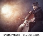 close up of cellist playing... | Shutterstock . vector #1122518306