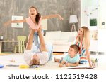 parents spending time with... | Shutterstock . vector #1122519428