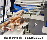 packing of bread at the factory | Shutterstock . vector #1122521825