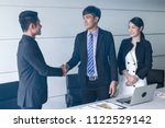 business people handshake while ... | Shutterstock . vector #1122529142