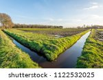 typical dutch agricultural... | Shutterstock . vector #1122532025
