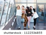 four young charming women... | Shutterstock . vector #1122536855