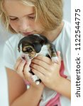 child with dog | Shutterstock . vector #1122544775