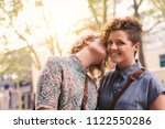 affectionate young woman... | Shutterstock . vector #1122550286