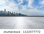 empty square with city skyline... | Shutterstock . vector #1122577772