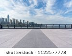 empty square with city skyline... | Shutterstock . vector #1122577778