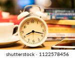 white clock on working  table... | Shutterstock . vector #1122578456