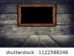 wood sign on wooden wall... | Shutterstock . vector #1122588248
