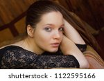 pretty woman portrait in a cozy ... | Shutterstock . vector #1122595166