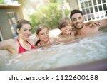 Family Of 4 Enjoying Bath In...