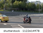 the motorcyclist on the road of ... | Shutterstock . vector #1122614978