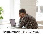depressed caucasian worker... | Shutterstock . vector #1122615902