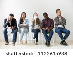 diverse casual work candidates... | Shutterstock . vector #1122615938