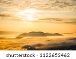 sunrise and the mist in winter...   Shutterstock . vector #1122653462
