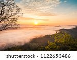 sunrise and the mist in winter...   Shutterstock . vector #1122653486