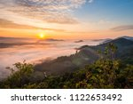 sunrise and the mist in winter...   Shutterstock . vector #1122653492