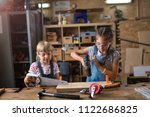 two young girls doing woodwork... | Shutterstock . vector #1122686825