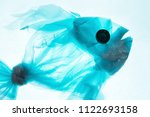fish from a plastic bag. blue... | Shutterstock . vector #1122693158