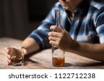 alcoholism  alcohol addiction... | Shutterstock . vector #1122712238