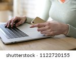 woman is working on computer... | Shutterstock . vector #1122720155