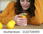 young woman with cup of tea ... | Shutterstock . vector #1122720455