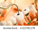 dentist cleaning teeth with... | Shutterstock . vector #1122781178