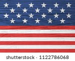 usa flag elements on wood... | Shutterstock . vector #1122786068