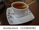 a cup of tea on a saucer with a ... | Shutterstock . vector #1122806582