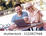 couple in bar using laptop... | Shutterstock . vector #1122827468