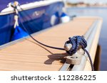 A Blue Yacht Moored With A Line ...