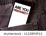 Small photo of Writing note showing Are You Prepared Question. Business photo showcasing Ready Preparedness Readiness Assessment Evaluation Words written black Phone white Screen Back pocket grey jeans trousers.