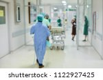 blurred of medical team moving... | Shutterstock . vector #1122927425