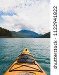 kayaking in eklutna lake ... | Shutterstock . vector #1122941822
