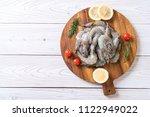 fresh shrimps or prawns raw on... | Shutterstock . vector #1122949022