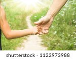 the parent holding the child's... | Shutterstock . vector #1122973988