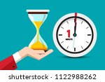 hourglass time symbol on blue... | Shutterstock .eps vector #1122988262