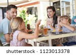 family on vacation having lunch ... | Shutterstock . vector #1123013378