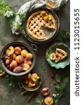 fruit pie on colorful wooden... | Shutterstock . vector #1123015655