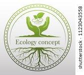 green tree logo on human hand... | Shutterstock .eps vector #1123043558