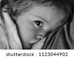 lactation. baby fair haired... | Shutterstock . vector #1123044902