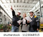 a group of young engineers at... | Shutterstock . vector #1123068515