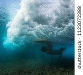 Surfer Perform Trick Named In...