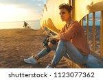 young beautiful hiking girl... | Shutterstock . vector #1123077362