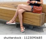 woman with naked legs sitting... | Shutterstock . vector #1123090685