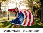 patriotic girl with american...   Shutterstock . vector #1123090805