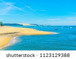 view of a sandy beach in... | Shutterstock . vector #1123129388