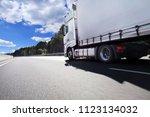 a fast truck running on the... | Shutterstock . vector #1123134032