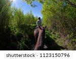 riding a horse in new zealand.... | Shutterstock . vector #1123150796